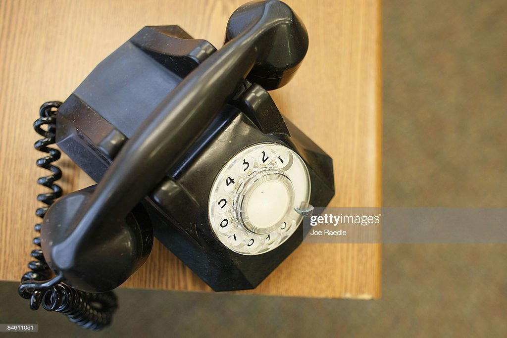 A rotary phone sits on desk of the newly opened Black Police Precinct and Courthouse Museum February 3, 2009 in Miami, Florida. The museum is located in the only known structure in the nation that was designed, devoted to and operated as a separate station house and municipal court for African-Americans. In September 1944, the first black patrolmen were sworn in as emergency policemen to enforce the law in what was then called the 'Central Negro District.' The precinct building opened in May 1950 to provide a station house for the black policemen and a courtroom for black judges in which to adjudicate black defendants. The building operated from 1950 until its closing in 1963.