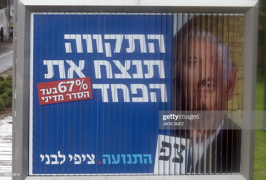 A rotating board shows election campaign posters for Israeli Prime Minister Benjamin Netanyahu (R) and Likud party leader and Israel's former foreign minister and chairman of a new party called The Movement, Tzipi Livni (L) on January 8, 2013 in the Mediterranean coastal city of Tel Aviv ahead of the countrys general elections.