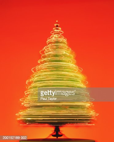 rotating christmas tree with white lights long exposure stock photo