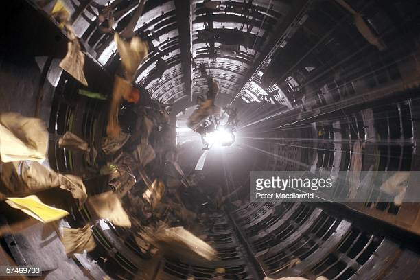 A rotating cylindrical sorting tunnel called the 'Trommel' sorts waste into three sizes for hand separating at the Materials Recovery Facility on...