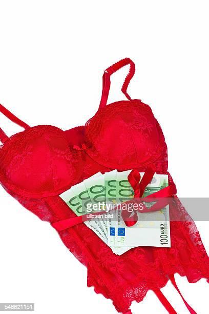 Rote Dessous mit Geldscheinen Prostitution und käufliche Liebe