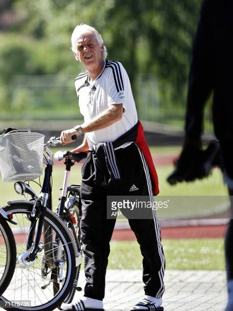 Dutch head coach of Trinidad and Tobago team Leo Beenhakker arrives in a bicycle to a training session at ' In der Ahe ' stadium in Rotenburg...