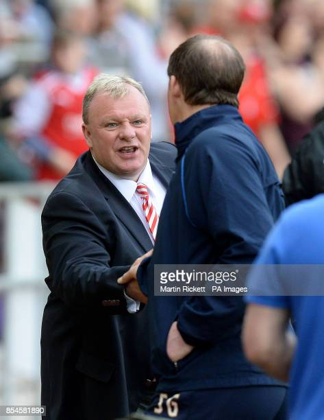 Rotherham United manager Steve Evans shakes hands with Preston North End manager Simon Grayson during the Sky Bet League One Playoff Semi Final...