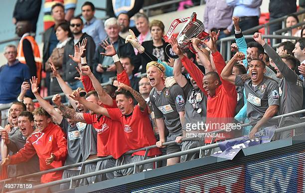 Rotherham United players lift the trophy as they celebrate victory after winning the English League 1 PlayOff final football match between Leyton...