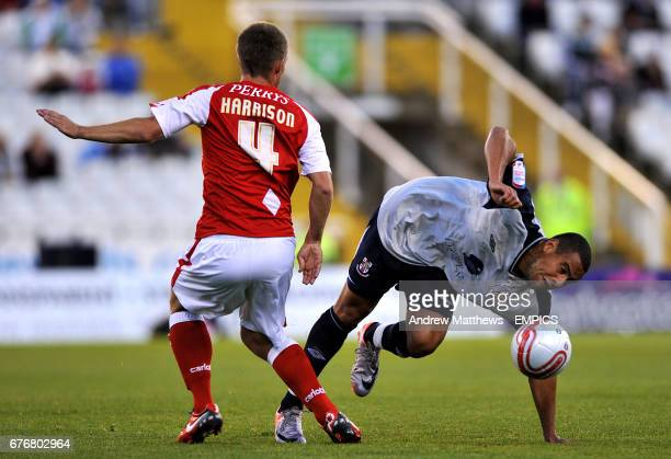 Rotherham United's Danny Harrison and Lincoln City's Ben Hutchinson battle for the ball