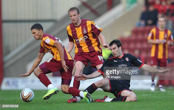 Rotherham United's Danny Schofield fouls Bradford City's Nahki Wells during the npower Football League Two match at Coral Windows Stadium Bradford
