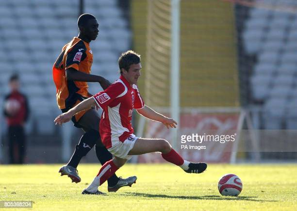 Rotherham United's Jamie Green and Barnet's Yannick Bolasie in action during the CocaCola League Two match at the Don Valley Stadium Rotherham