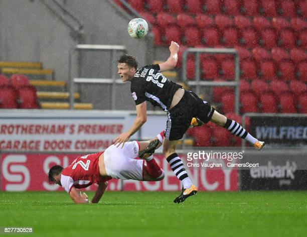 Rotherham United's Kieffer Moore is fouled by Lincoln City's Rob Dickie during the Carabao Cup First Round match between Rotherham United and Lincoln...
