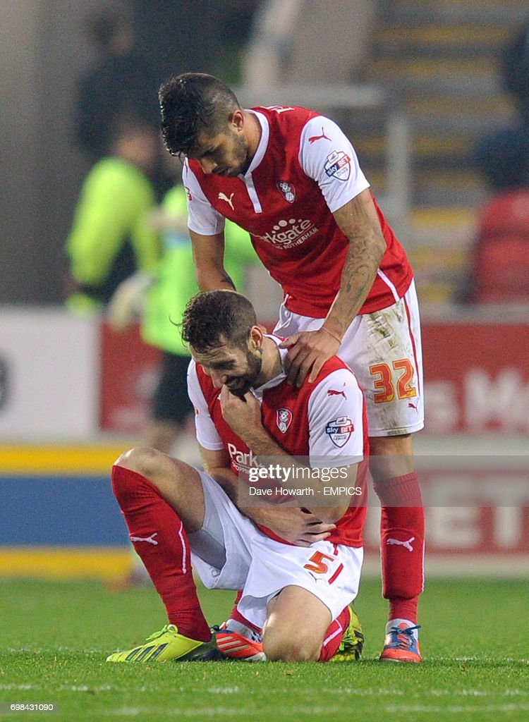 Rotherham United's Kirk Broadfoot holds his shoulder in agony before being taken off