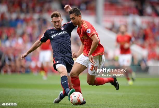 Rotherham United's Lee Frecklington battles for the ball against Nottingham Forest's Tyler Walker