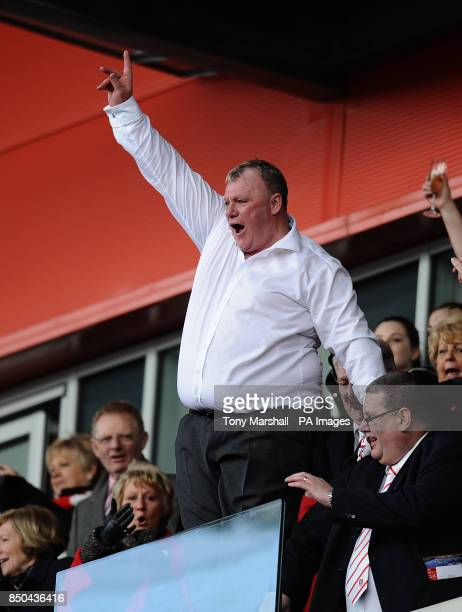 Rotherham United's manager Steve Evans celebrates in the stands at the end of the npower League Two match at the New York Stadium Rotherham