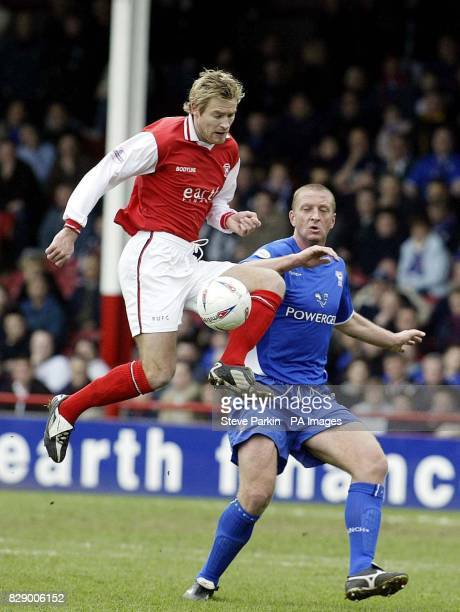 Rotherham United's Martin Butler clears the ball from Ipswich Town's Matt Elliott during the Nationwide Division One match at the Millmoor Ground...