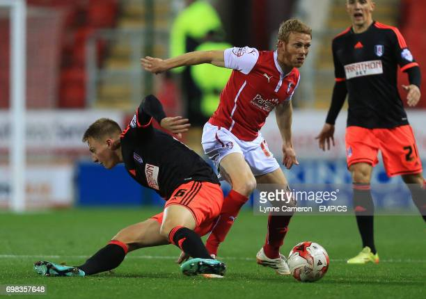 Rotherham United's Paul Green and Fulham's Cauley Woodrow battle for the ball