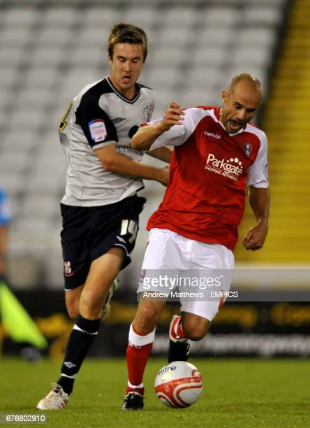 Rotherham United's Paul Warne and Lincoln City's Josh O'Keefe battle for the ball
