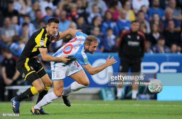 Rotherham United's Richard Wood and Huddersfield Town's Laurent Depoitre battle for the ball during the Carabao Cup Second Round match at the John...
