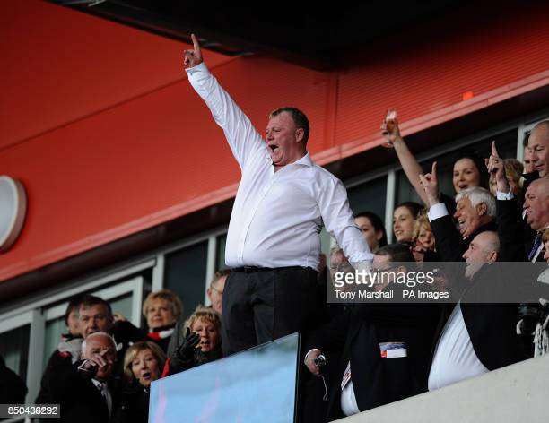 Rotherham Utd's manager Steve Evans celebrates in the stand as his team are promoted during the npower League Two match at the New York Stadium...