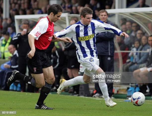 Rotherham's David Worrell in action with Colchester's Mark Yeates during the CocaCola League One match at Layer Road Colchester