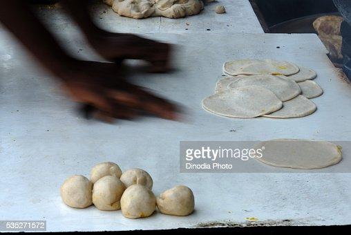 Roti frying on a hot plate in Mumbai, Maharashtra, India.