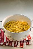 Rotini pasta in colander, studio shot