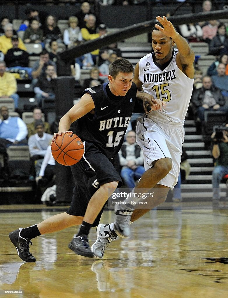 Rotnei Clarke #15 of the Butler Bulldogs drives past Kevin Bright #15 of the Vanderbilt Commodores at Memorial Gym on December 29, 2012 in Nashville, Tennessee.