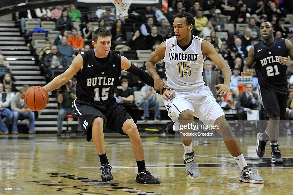 Rotnei Clarke #15 of the Butler Bulldogs plays against Kevin Bright #15 of the Vanderbilt Commodores at Memorial Gym on December 29, 2012 in Nashville, Tennessee.