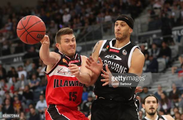 Rotnei Clarke of the Hawks and Josh Boone of United compete for the ball during the round 18 NBL match between Melbourne United and the Illawarra...