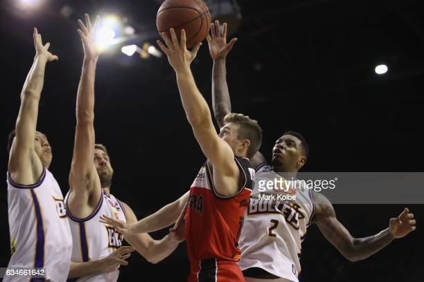 Rotnei Clarke of the Hawks lays up a shot under pressure during the round 19 NBL match between the Illawarra Hawks and the Brisbane Bullets at...