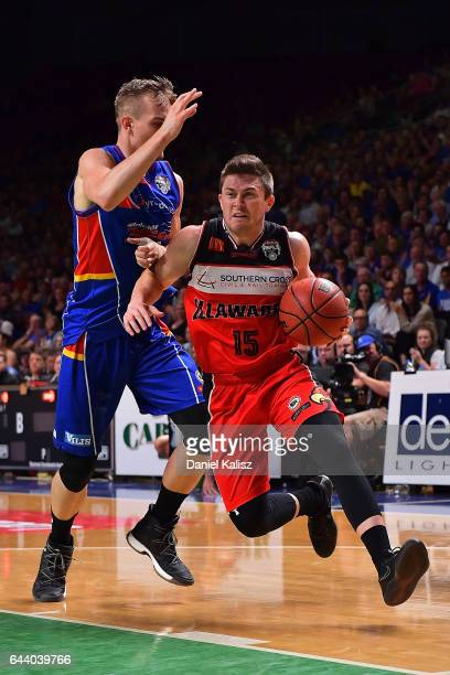 Rotnei Clarke of the Illawarra Hawks drives to the basket as Anthony Drmic of the Adelaide 36ers defends during game three of the NBL Semi Final...