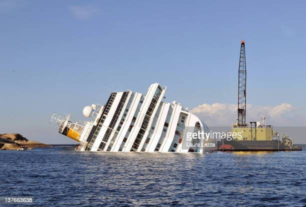 Rotterdam based SMIT and Livorno based NERI salvage workers start their work of diesel recovery on a pontoon from the the cruise ship Costa Concordia...