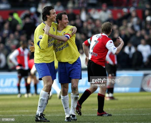 RKC Waalwijk's players Tim Bakens and Patrick van Diemen celebrate after scoring 11 while Feyenoord's player Dirk Kuyt is made at his teammates...