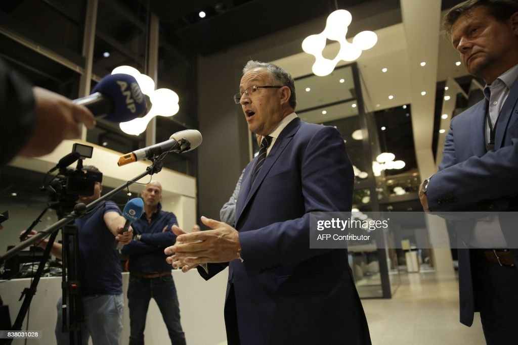 Rotterdam's Mayor Ahmed Aboutaleb speaks to the press after a rock concert was cancelled due to a terror threat, in Rotterdam, The Netherlands, on August 23, 2017. A rock concert in Rotterdam was cancelled on August 23 due to a terror threat involving a Spanish van found with gas bottles inside, the local mayor said. Earlier the Maassilo venue announced that 'due to a terrorist threat, the Allah-Las concert will not take place this evening, on police orders'. Rotterdam police confirmed the decision was taken due to a 'possible terrorist threat' and that the van's driver had been arrested. / AFP PHOTO / ANP / Arie Kievit / Netherlands OUT