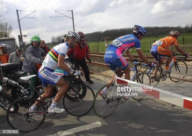 Belgian Tom Boonen Italian Alessandro Ballan and Spain's Juan Antonio Flecha ride a railway crossing during the 104th ParisRoubaix cycling classic...