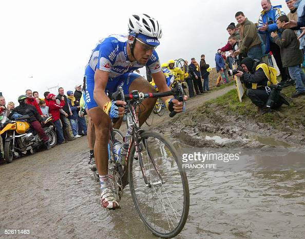 Belgian Tom Boonen rides in the leading pack on a cobblestone road during the 103rd ParisRoubaix cycling race 10 April 2005 between Compiegne and...
