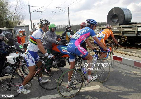 Belgium's Tom Boonen Italy's Alessandro Ballan and Spain's Juan Antonio Flecha wait to allow the passing of train during the 104th ParisRoubaix...