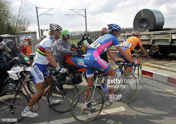 Belgium's Tom Boonen Italy's Alessandro Ballan and Spain's Juan Antonio Flecha wait to allow the passing of train during the 104th ParisRoubaix...