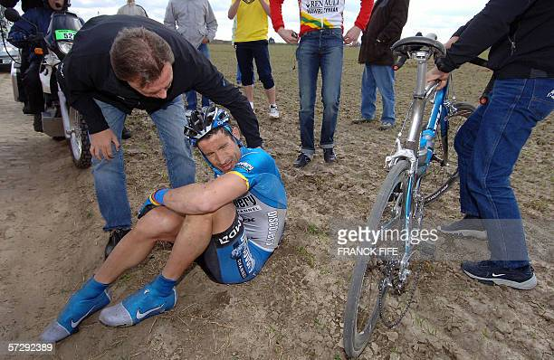 Us cyclist Georges Hincapie reacts after he fell down during the 104th ParisRoubaix cycling classic race between Compiegne and Roubaix 09 April 2006...