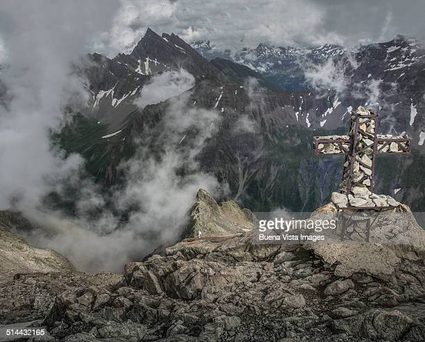 Rough cross on a mountain summit
