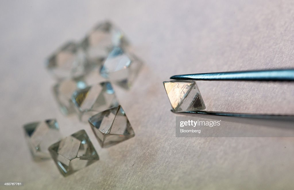 A rough cut diamond is held with tweezers during processing in the sorting center at OAO Alrosa's Mir diamond mine in Mirny, Russia, on Thursday, Nov. 14, 2013. OAO Alrosa, the world's largest diamond producer, raised about $1.3 billion in an oversubscribed share sale from investors including Oppenheimer Funds Inc. and Lazard Ltd.'s asset-management unit, First Deputy Prime Minister Igor Shuvalov said. Photographer: Andrey Rudakov/Bloomberg via Getty Images