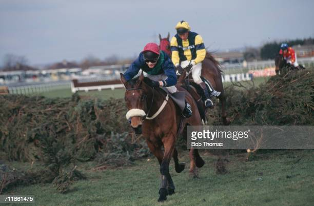 Rough Quest with Mick Fitzgerald up takes The Chair before going on to win the Grand National at Aintree Racecourse Liverpool 30th March 1996