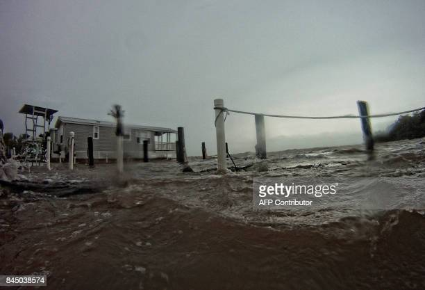 Rough seas are seen around a house in the Florida Keys as winds and rain from the outer bands of Hurricane Irma arrive in Islamorada Florida on...
