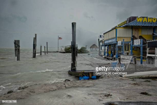 TOPSHOT Rough surf churned up buy the approaching hurricane damage the docks at Whale harbour in the Florida Keys as winds and rain from the outer...