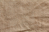 Rough texture of burlap, textile background closeup. Sackcloth canvas.