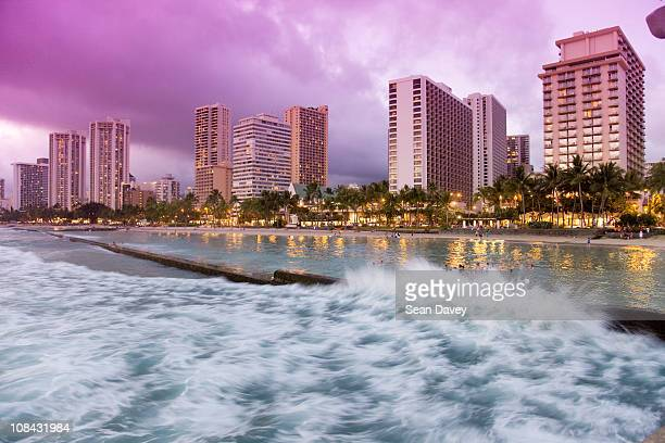 Rough waves during sunset at Waikiki beach, in Honolulu.