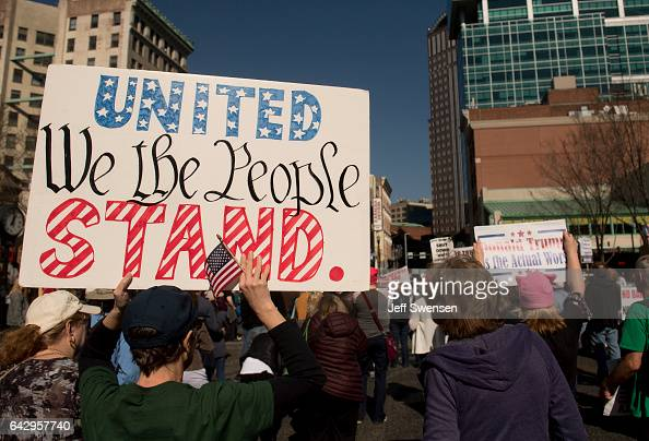 Roughly 100 antiTrump protesters demonstrate peacefully in Market Square on February 19 2017 in Pittsburgh Pennsylvania The protesters voiced their...