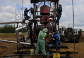 Roughnecks build a drilling rig at the MEG Energy site near Fort McMurrayThere is explosive growth in the oil field areas around Fort McMurray...