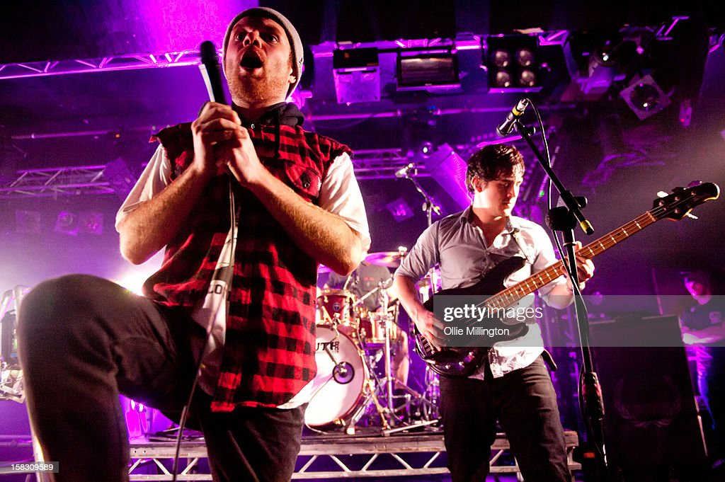 Roughton 'Rou' Reynolds and Chris Batten of Enter Shikari Perform onstage during a day of the 5th UK leg of their A Flash Flood of Colour World Tour called A Flash Flood Of Christmas; at Rock City on December 12, 2012 in Nottingham, England.