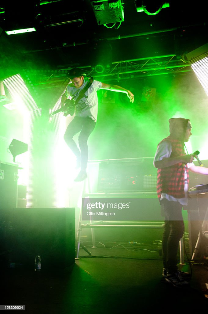 Roughton 'Rou' Reynolds and Liam 'Rory' Clewlow of Enter Shikari Perform onstage during a day of the 5th UK leg of their A Flash Flood of Colour World Tour called A Flash Flood Of Christmas; at Rock City on December 12, 2012 in Nottingham, England.