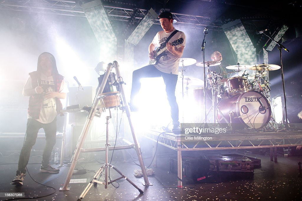 Roughton 'Rou' Reynolds, Chris Batten and Rob Rolfe of Enter Shikari Perform onstage during a day of the 5th UK leg of their A Flash Flood of Colour World Tour called A Flash Flood Of Christmas; at Rock City on December 12, 2012 in Nottingham, England.