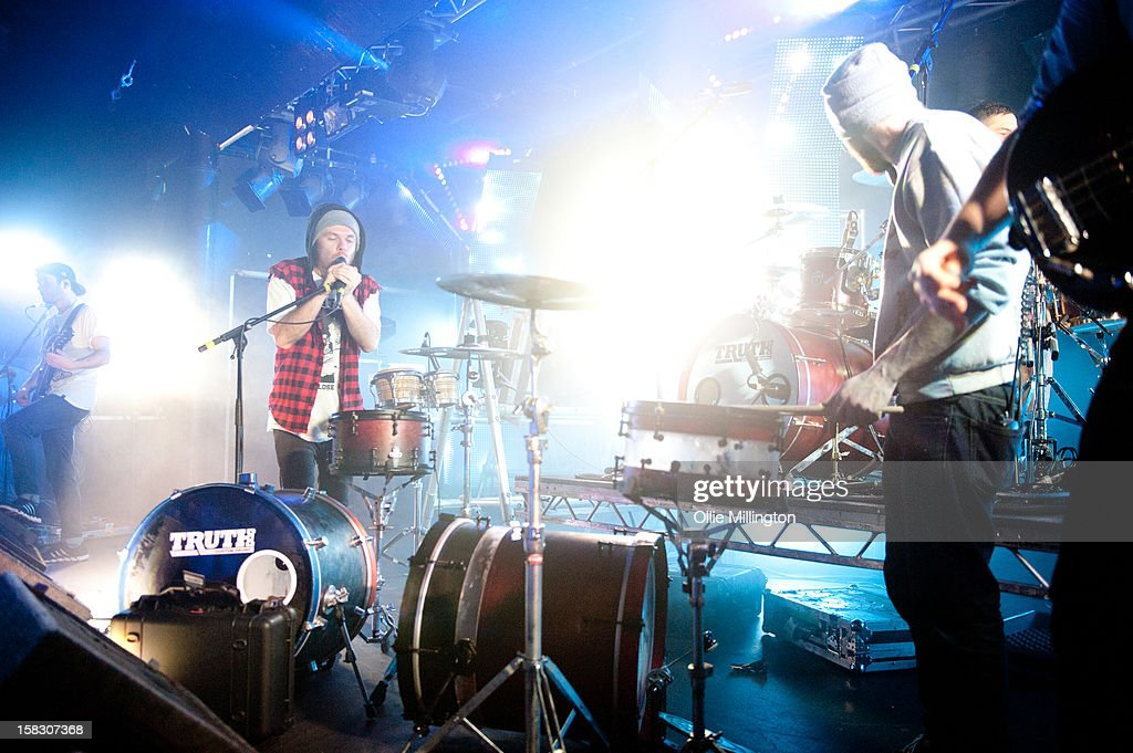 Roughton 'Rou' Reynolds, Liam 'Rory' Clewlow and Chris Batten of Enter Shikari Perform onstage during a day of the 5th UK leg of their A Flash Flood of Colour World Tour called A Flash Flood Of Christmas; at Rock City on December 12, 2012 in Nottingham, England.