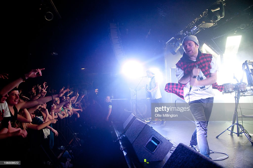 Roughton 'Rou' Reynolds, Liam 'Rory' Clewlow and Chris Batten of Enter Shikari Performs onstage during a day of the 5th UK leg of their A Flash Flood of Colour World Tour called A Flash Flood Of Christmas; at Rock City on December 12, 2012 in Nottingham, England.
